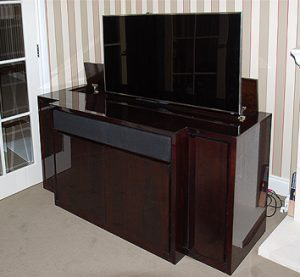 Bespoke break front TV cabinet with swivel for lounge