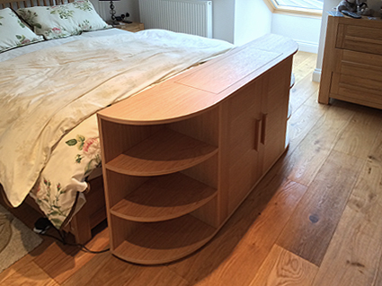 End of bed pop up television cabinet in oak