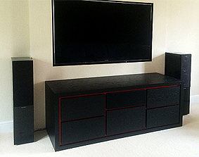 AV cabinet in ebonised oak with red shadow lines