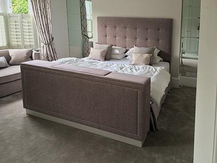Upholstered end of bed TV cabinet