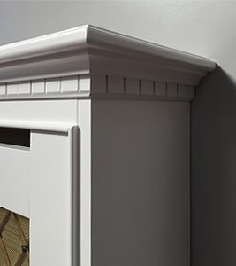 Radiator cover with brass top corner detail
