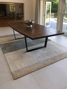 Bespoke dining table in Oak and steel