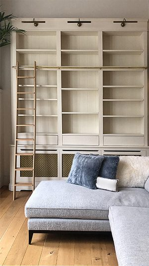 Radiator cover bookcase with library ladder